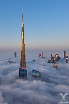 Burj Khalifa towering above the clouds this is the highest skyscraper in the world at the moment. its height of 828 meters . 163 floor