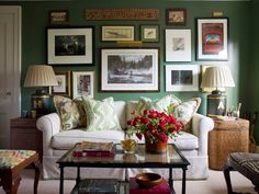 I am a sucker for emerald green walls! Also, love the picture collage decorating the wall.
