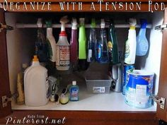 Use a Tension Rod to Tidy up under the Kitchen Sink. | 19 Insanely Clever Organizing Hacks