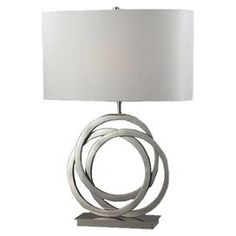 """Pen thank you notes or finish your latest book club read beside this chic table lamp, showcasing an interlocking ring base with a crisp white drum shade.       Product: Table lamp   Construction Material: Metal and faux silk   Color: Polished nickel and white  Features: 3-Way switch    Accommodates: (1) 150 Watt medium bulb - not included  Dimensions: 25"""" H x 18"""" W x 18"""" D"""