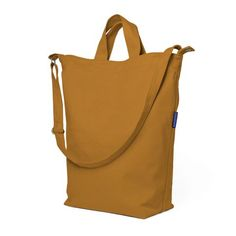"""A market carry-all, this is the perfect everyday tote. Carry in your hand, on your shoulder or across your chest. Brings home everything from a laptop to groceries. Bring home the world this season. 16"""" high / 10"""" wide / 5.5"""" deep. 40"""" adjustable shoulder strap. Snap Closure. Interior pocket."""