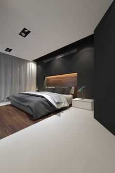 Gorgeous contrast between the flats wall colour and the wooden floor channelling up to the headboard.
