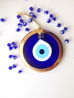 A personal favourite from my Etsy shop https://www.etsy.com/listing/292097749/evil-eye-bead-13cm-gold-evil-eye-wall