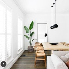 We love the simple mirror at the end of the room and those pendant lights are perfect via @linzoshouse on Instagram
