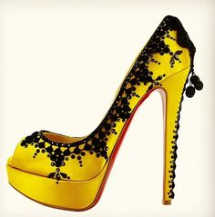 via @MsCoutureCloset - sexy sexy yellow Louboutin heels adorned with black accents