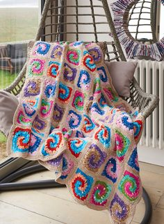 The swirly crochet granny squares make this grannyghan a perfect kid-friendly project!