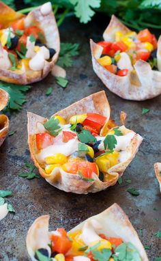 Southwest Veggie Won-ton Cups: quick, easy and uber customizable, they're filled with fresh corn, beans and peppers and topped with a chipotle yogurt sauce!