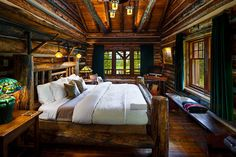 The Grand Stone Fireplace, The Wooden Beams, The Cozy Bed, And The Breathtaking Views—What's NOT To Like About This Country Log Home Design?