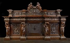 A grand Antique Venetian Baroque style carved walnut sideboard.