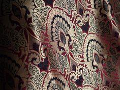 Silk Brocade Fabric in Maroon Gold Weaving, Banaras Brocade Fabric. This is a exclusive and beautiful pure heavy benarse silk brocade floral design fabric in Maroon, black and Gold. The fabric...
