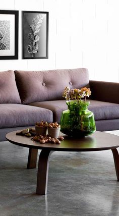A modern spin on the classic button tufted sofa with flared arms.