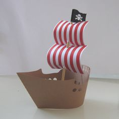 paper pirate ship form... starch lace around form, spray paint gold, add crystals for sparkle... hang from lamp kit