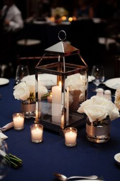 Navy and blush lantern, candle and flower wedding centrepiece