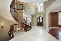 Magnificent entry foyer with curved staircases to multi levels