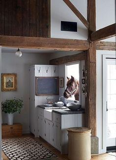 This stunningly elegant and rustic kitchen with exposed beams, designed by James Huniford as seen in Elle Decor, is the stuff country-home fantasies are made of.