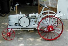 Home made garden tractor with DAVID BRADLY grill McCORMICK DEARING engine (2.5 hp) looks like a MODEL T  steering column and a glass door knob attached a control rod.
