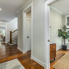 Welcoming foyer with engineered hardwood flooring, crown moulding, neutral gray paint, recessed lights and a sightline to the back of the home. This craftsman home is listed in Vienna, Virginia for $1.399M by The Casey Samson Team is a Wall Street Journal Top Team in Northern Virginia.