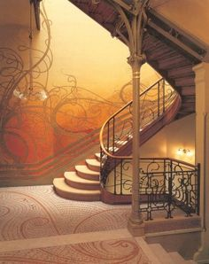 Art Nouveau Interior Design - This could be overdone, but the mural on the wall behind the staircase is beautiful