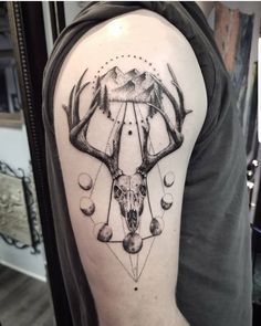 Upper arm tattoo cover | Photo by (inkedmag) on Instagram | #pasesofthemoon #dotwork #deerskull #linework #upperarmtattoo #blackandgrey #artist #tattooartist #nctattooers #ink #tattoolovers #femaletattooartist #ladytattooist #inkedguys #guyswithtattoos #charlotteartist #girlswithgauges #girlswithtattoos #girlswithpiercings #stretchedears #piercedgirls Upper Arm Tattoos, Female Tattoo Artists, Piercings For Girls, Deer Skulls, Inked Men, Stretched Ears, Cover Tattoo, Cover Photos, Tattoos For Guys