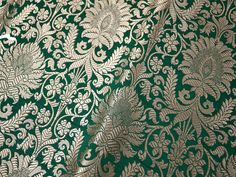 Green Brocade Fabric, indian brocade, Banaras silk, Silk Brocade Fabric. This is a beautiful heavy Banarasi blended silk brocade floral design fabric in Green and Gold. The fabric illustrate golden woven floral design on Green background. Fabric Type: Blended Silk (Viscose and Silk) Super Fine Quality Brocade Weaving from Banaras, which is known as Kimkhab. During the Mughal period (1556–1707), when kimkhwāb was extremely popular with the rich, the great centres of brocade weaving were…