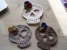 Crocheted skeleton faces for Halloween...be a good item for a goodie bag at a party.
