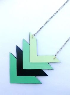 Pin for Later: 33 Awesome Ways to Upcycle Paint Chips Paint Chip Necklace Turn paint chips into wearable art, such as this neat chevron necklace.