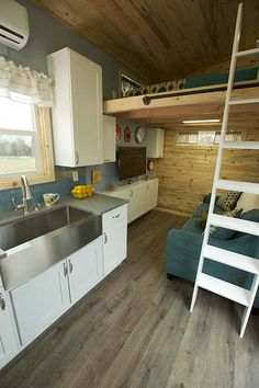 This tiny towable house is also prepared for all weather and seasonal changes, as it has a heating unit and a mini-split air conditioner.
