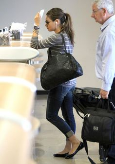 Mila Kunis with her Chanel bag at LAX airport in Los Angeles on August 29, 2011.