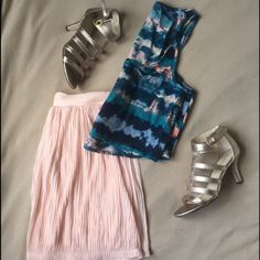 Chiffon flowy pleated skirt Worn only a couple of times. So cute and versatile. Zip closure in back. Has a liner but you'll still want to wear light-colored undies. Urban Outfitters Skirts Mini