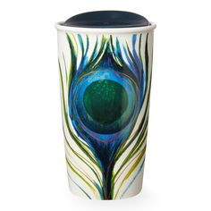 A double-walled ceramic mug with artwork reminiscent of a peacock feather, part of the Dot Collection.