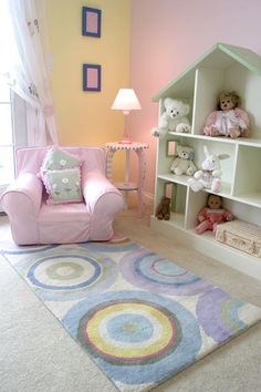 Jaymes Richardson  Interior Designer, Civility Design Website ~ Designer's Notes:    This colorful space in a little girl's bedroom allows for reading and playing and is also defined with the colorful and playful area rug.
