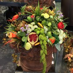 This is a large stunning permanent arrangement of rich, textural and realistic fruits and flowers in vibrant fall colors in a faux pottery container.   Permanent Botanicals provide an enriched seasonal environment for your home or office for years to come.  We can also custom design a permanent arrangement for your space.