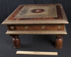 BRASS AND WOOD ASIAN TEA TABLE. MEASURES 10 INCHES HIGH, 18 INCHES WIDE AND 18 INCHES DEEP.