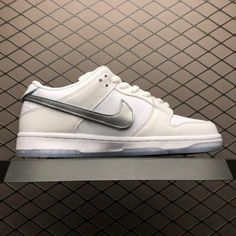 b89a11563141 This Nike SB Dunk Low Tiffany 2018 Pack White shoe sports a croc-like  textured leather upper to mimic the classic Tiffany SBs