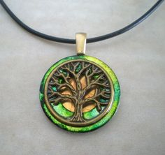 I found 'Tree of Life Necklace: Emerald Green - Tree Jewelry - Upcycled Jewelry - Celtic Jewelry - Spring Jewelry - Earth Day - Wiccan Jewelry' on Wish, check it out!