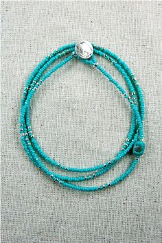 Aqua seed beads with splash of silver and a Buffalo nickel toggle