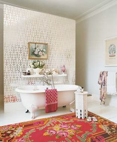 Glamorous bathroom,that has to be a walk through shower behind that wall... and I love that rug.