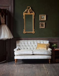 The Emily sofa is a most unusual design entirely devoid of straight lines. The back, front, side rails and arms are subtly curved, creating a charmingly shaped small sofa.