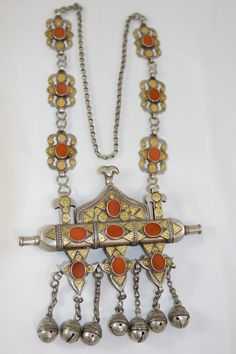"Vintage Yamut Turkman necklace. Gilded Afghan silver with carnelian cabochons. Necklace hangs 38"" long."