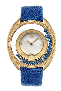 #Versace. it seems a beautiful design in motion. the blue beads look like fluid.