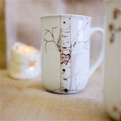 Fantastic wedding or anniversary gift for someone who seems to have everything.  Personalize it with couples initials and wedding year.  Birch mug set of 4 personalized porcelain mugs, dishwasher and microwave safe.