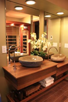 I designed this zen inspired bath with a 2 tiered vanity made out of exotic wood.