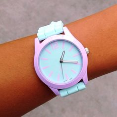 Have fun wearing this fresh mint and light lavender colored watch! It also has minty silicone wrist bands and is constructed with stainless steel hardware. The straps are adjustable to create the perf