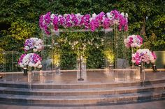 Lucite Ceremony Structure with Purple Flowers  Photography: Joe Latter Photographer Read More: http://www.insideweddings.com/weddings/glamorous-outdoor-ceremony-ballroom-reception-with-purple-details/744/