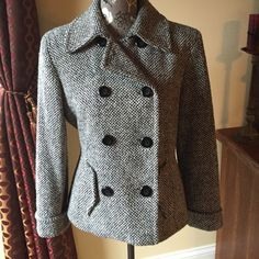 🎀Host Pick🎀 Black and white wool pea coat 🎀Host Pick Cozy Casual Party 12/5/16🎀 Black and white fully lined pea coat by Mixit. Size small.  Can be buttoned all the way up or left open. 2 pockets on front. Extra buttons sewn on inside. 50% wool, 20%polyester, 20% acrylic, 10% nylon. Lining 100% polyester. Dry clean only. Some light piling but hardly noticeable with pattern. Jackets & Coats Pea Coats
