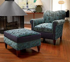 Molly Rose Chair in Aqua by Mary Lynn O'Shea.  The artist's own jacquard color combinations bring vibrancy and verve to her double-cloth cotton and rayon fabric. Kiln-dried hardwood frame with double doweled joints and blocked corners. Hand-tied deep seating coils tied in 8 directions. Spring-down cushions offer strength and comfort.  Find it at www.artfulhome.com
