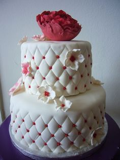 Quilted anniversary cake for a 40th anniversary.  Fondant flowers and a gumpaste peony on top
