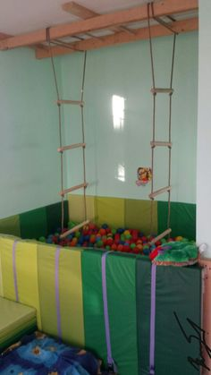 A ball pit with Ikea mats, rope ladder and home made monkey bars. We made it for our 3 year old son with SPD to meet his proprioception and vestibular seeking. This is his favorite part of his sensory room. Particularly after school he requests to climb the rope ladder, swing on the monkey bars and then drop into the balls. 2-3 rounds to self- regulate and he is ready to concentrate on a table top activity or eat dinner with us :) find more info at www.oursensoryadventures.com