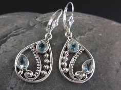 Made with 5mm faceted blue topaz gemstones and sterling silver metal and leverback earring wires.
