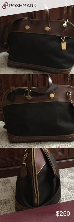 """Dooney and Bourke travel bag Dark brown cabriolet with chestnut leather handles and trim, 40"""" canvas strap that is adjustable, handle drop is  4""""' bag width is 22"""", height is 13"""", depth is 9""""., inside has side gussets, attached strap for keys, and slip pocket holder on back wall...no marks or stains inside or out from a smoke free home Dooney & Bourke Bags Travel Bags"""